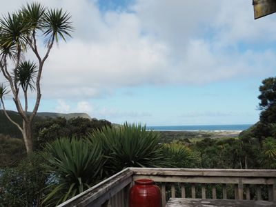 Photo for Ruru Cottage nestled at beautiful Bethells Beach