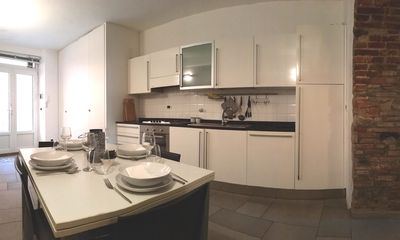 Del Tongo Kitchen with marble worktop. Extendable dining table. Large closet.