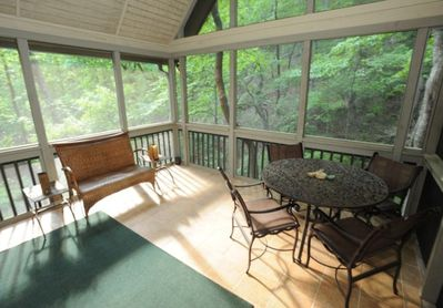 Screened porch is a fantastic spot for relaxing to the sounds of the waterfall