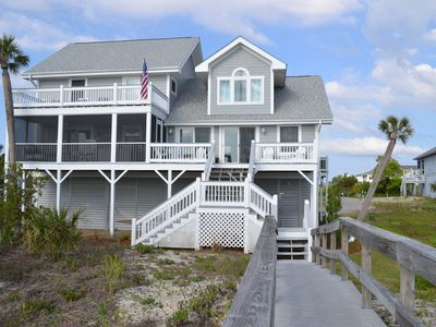 Ocean side of home with boardwalk to beach, 2 decks and large screened porch