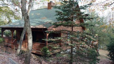 Beautiful Cedar cabin with wrap-around decks and porches