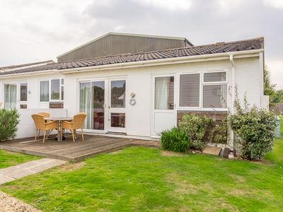 Photo for Welcome to the ideal cottage for an enjoyable family break. The large windows and glazed doors let t