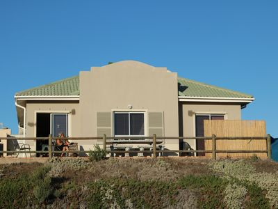 Photo for At the sea located 6 person bungalow unobstructed view of Robben Island and Table Mountain