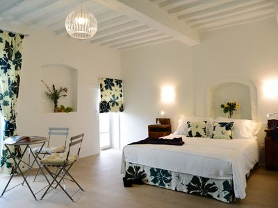 Photo for Contemporary decor in a Medieval townhouse: studio suite with Umbrian hill views