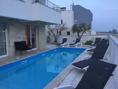 Photo for Apartment 80 sqm on the seafront with heated salt pool and boat