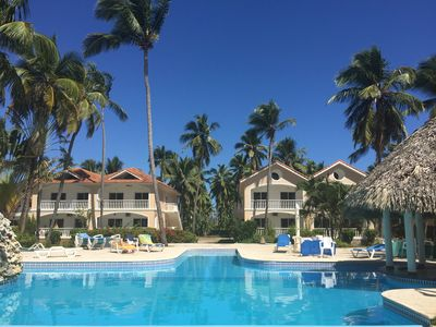 Photo for Fabulous Condo steps from the  private beach and beach-side pool.