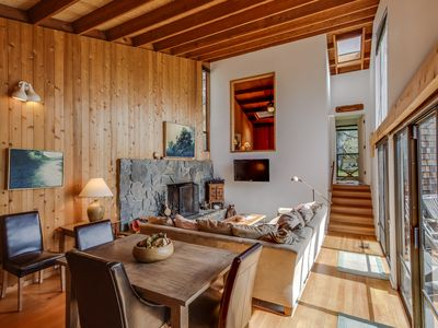 A private hot tub, shared pool, & amazing views await at the dog-friendly home
