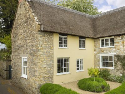 Photo for Pear Tree Cottage is a Grade II thatched cottage in the Dorset village of Netherbury.
