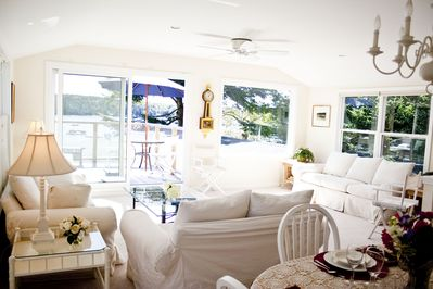 Upstairs living and dining room with deck overlooking harbor.
