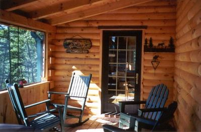 Screened In Porch - sitting area and picnic table.  Great of viewing the lake, w