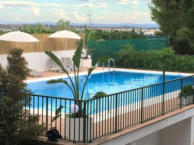 Photo for Homerez last minute deal - Spacious apt with swimming-pool