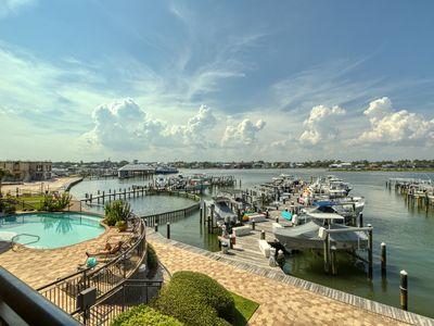 Photo for NEW LISTING! Waterfront condo w/ boat slip, shared pool, gym, & hot tub!
