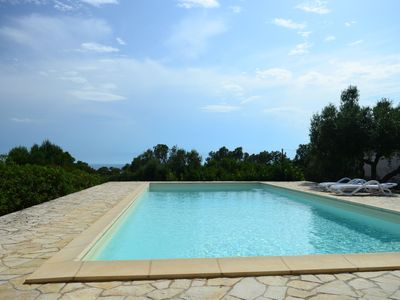 Photo for Salento: trullo with pool overlooking the sea