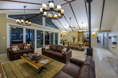 Spacious sitting and dining room opening to the main veranda