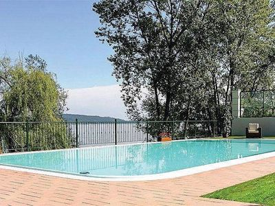 Photo for Villa Diaspro A: A bright and sunny one-story apartment located right on the Lake Maggiore, with Free WI-FI.
