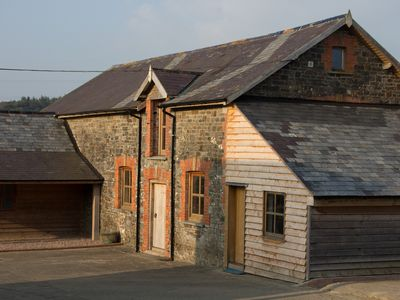 Photo for Contemporary barn conversion situated in the heart of the Devon countryside.