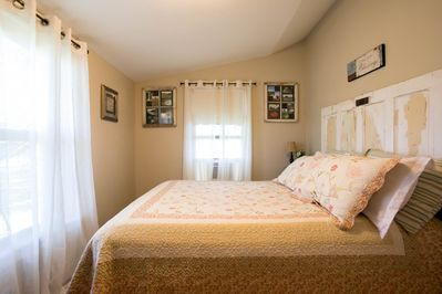 Master bedroom features a terrific king bed