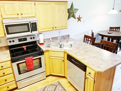 Full size stainless steal appliances including a dishwasher.