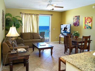 Spacious Living room area with view of the Gulf and beach. Huge flat screen tv.