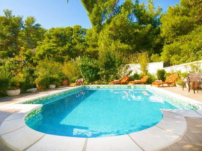 Photo for Near beach holiday home, quiet and secluded, large private pool, 4 min to beach