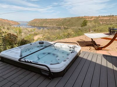 Photo for Stunning Reservoir Retreat with hot tub and views!