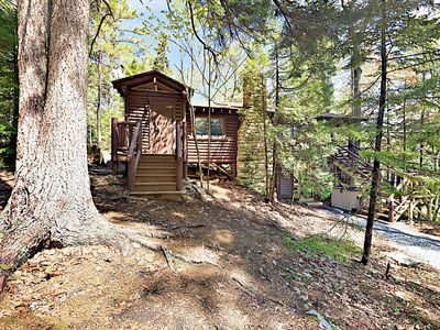 Your secluded vintage cabin is surrounded by pines