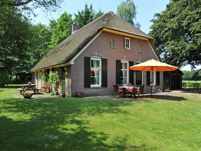 Photo for An authentic Veluwe farm house with thatched roof in the countryside