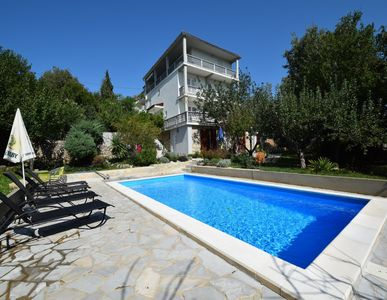 Photo for Holiday apartment with pool use 350 m from the beach