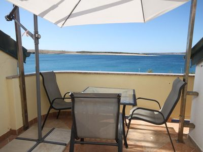 Photo for Two bedroom apartment with terrace and sea view Povljana, Pag (A-3316-f)