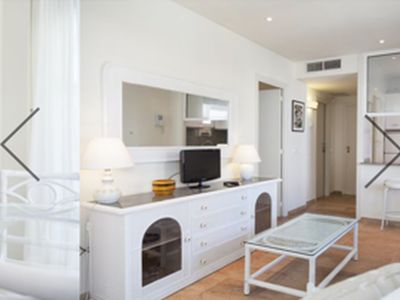 Photo for Great apt of 2 hbts. Beachfront right in the center of the promenade