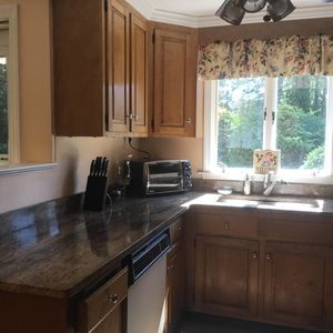 The kitchen is brand new with granite counter tops and garbage disposal