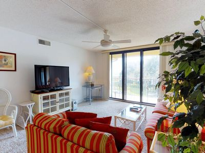 Photo for Spacious condo w/ beach access, shared pool, hot tub, ocean views & more!