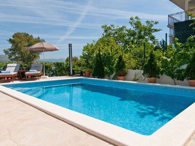 Photo for This 4-bedroom villa for up to 12 guests is located in Okrug Donji and has a private swimming pool,