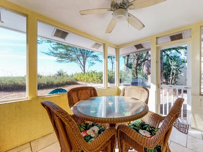 Photo for Quaint beachfront duplex in ideal location - screened lanai & free trolley!
