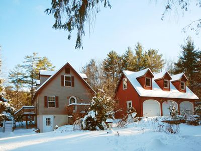House and 3 car garage in winter.