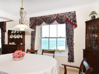 Photo for Clifftop apartment with superb sea views, WiFi and private parking.