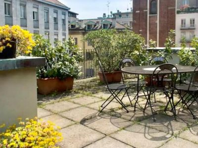 Photo for Amazing San Babila apartment in Centro Storico with WiFi, air conditioning, private terrace & lift.
