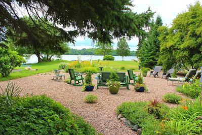 The expansive rear gardens invite family and friends to gather with a view of the lawn and Lake Michigamme.