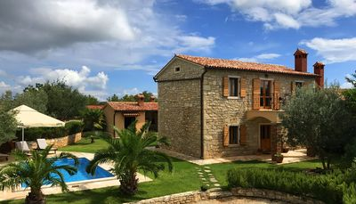 Photo for VILLA ORADA - Stylish stone house with pool and sea view for 6 people
