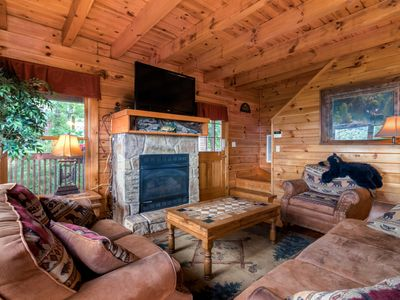 Rustic log cabin with private hot tub and panoramic Smoky Mountain views
