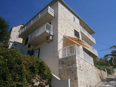 Photo for Two bedroom apartment with balcony and sea view Povlja, Brač (A-17472-a)