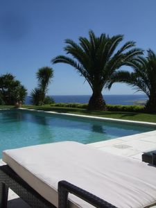 The pool over the blue Mediterranean sea