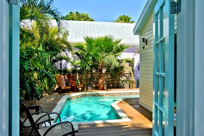 The L-shape private pool is right outside the living room