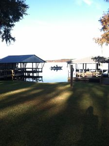 Your view of the creek from across the street. Your covered dock is on right.