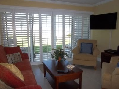 Family Room with Plantation shutters for privacy on the front glass doors.