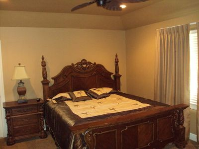 King size bed in the master bedroom suite upstairs