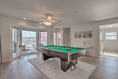 This high-end condo is complete with a C.L. Bailey pool table!