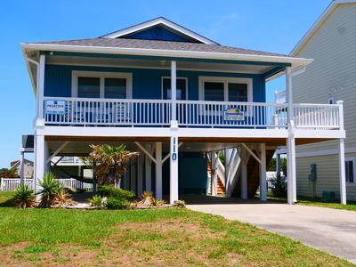 Photo for Steps off the beach, enjoy fabulous ocean views from your rocking chair front porch in this adorable 2 bedroom, 2 bath beach cottage, which sleeps 6 comfortably.