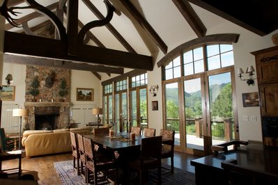 Living Room view doors open to huge private deck.60 in TV views of mt timpanogas