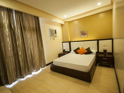 Photo for 1 Bedroom w/ Bathtub near Ayala, free weekly housekeeping, cable, wifi & parking